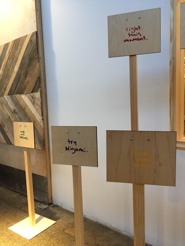 Signs at the Matthew Hoffman Art Showcase