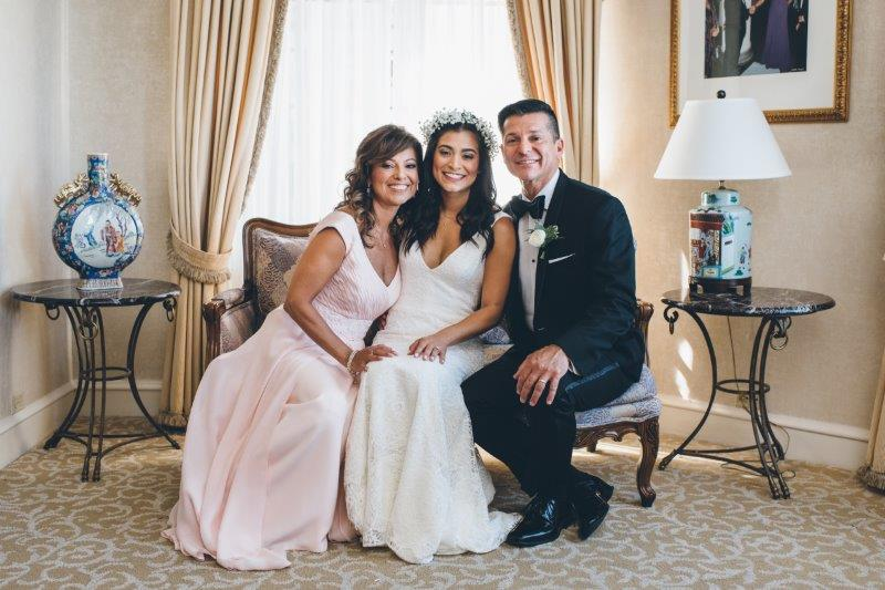 Happy Parents with their Blushing Bride