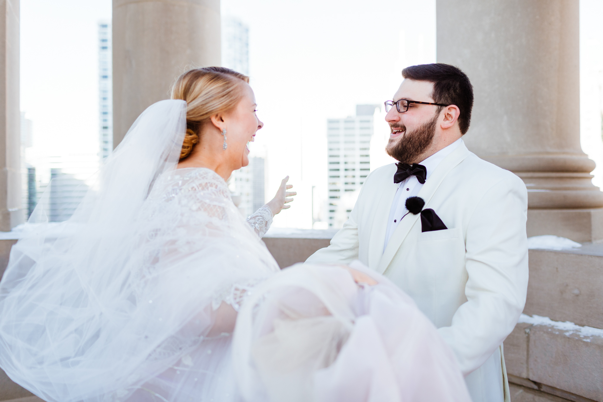 Bride and groom embrace after first look on their wedding day
