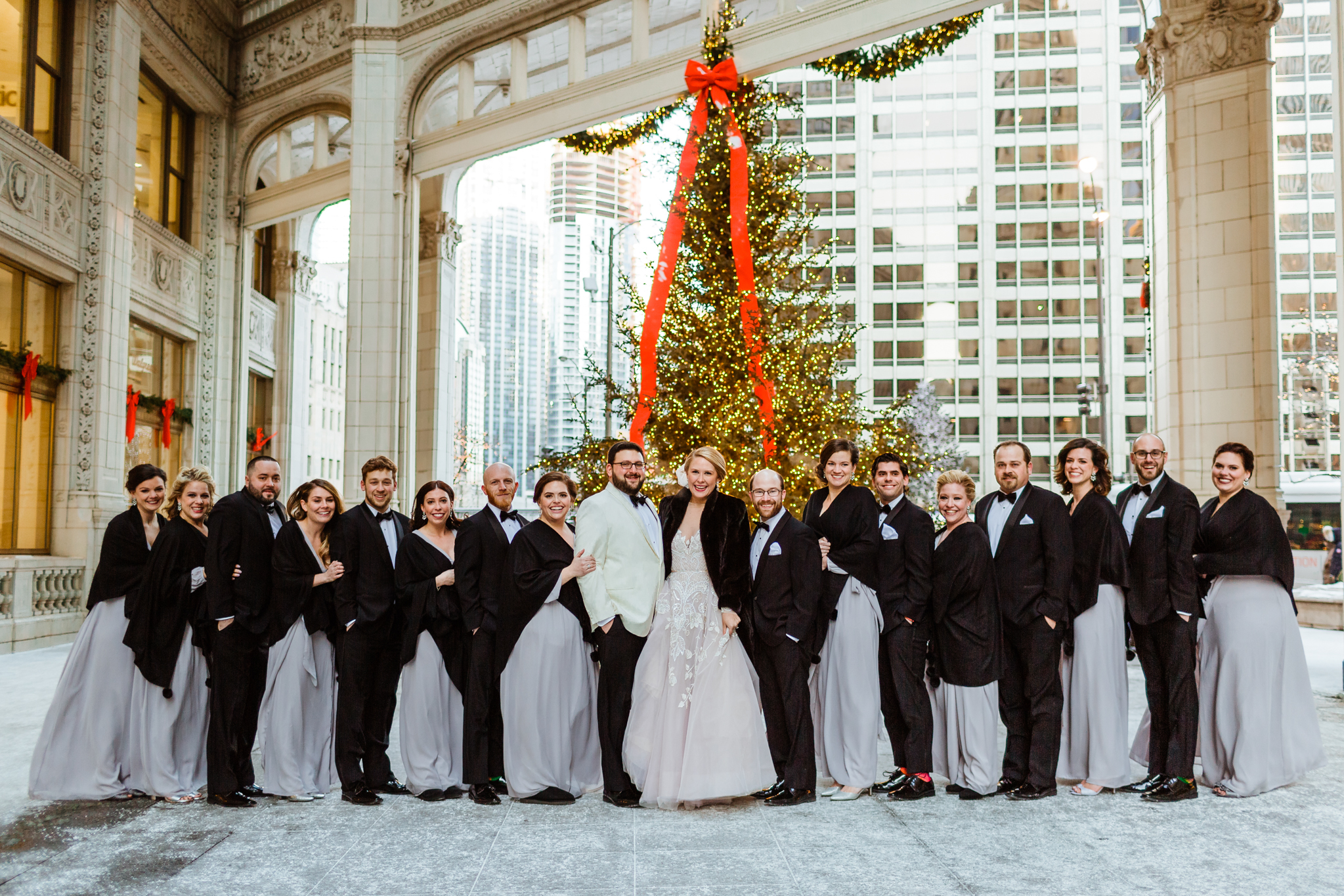 Bridal party in front of Christmas tree in downtown Chicago