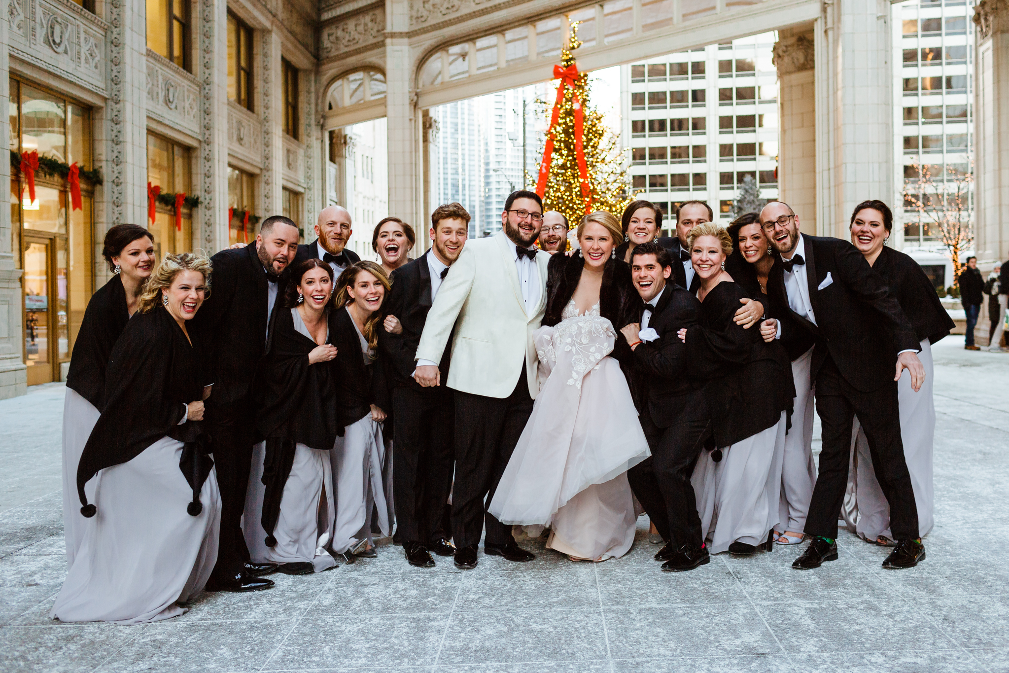 Bridal squad in front of Christmas tree in downtown Chicago