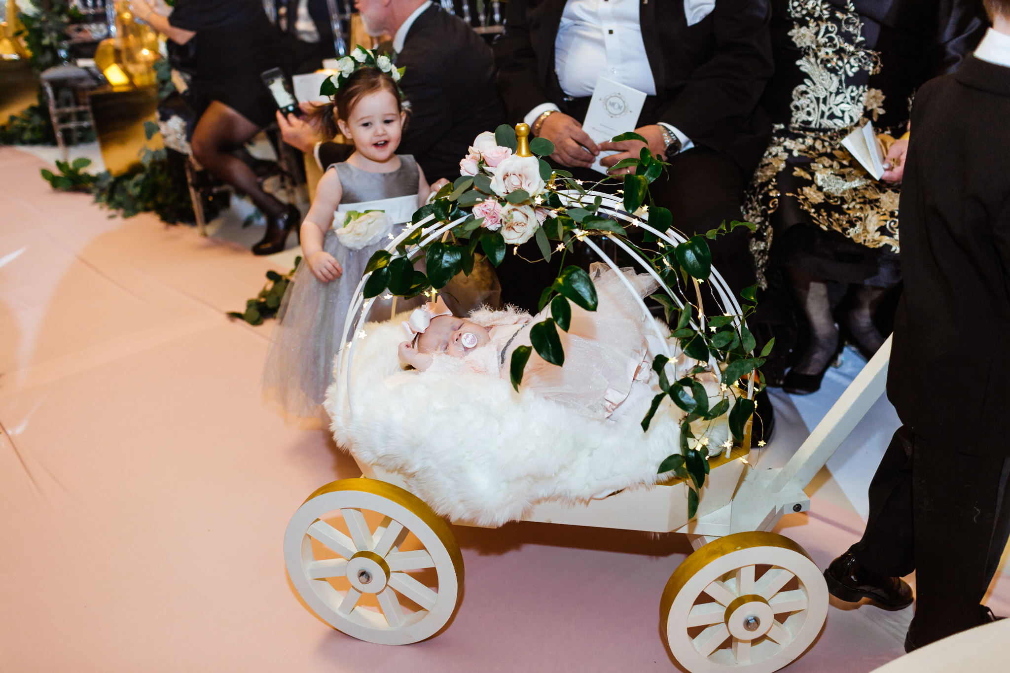 Sleeping baby in a carriage goes down the aisle