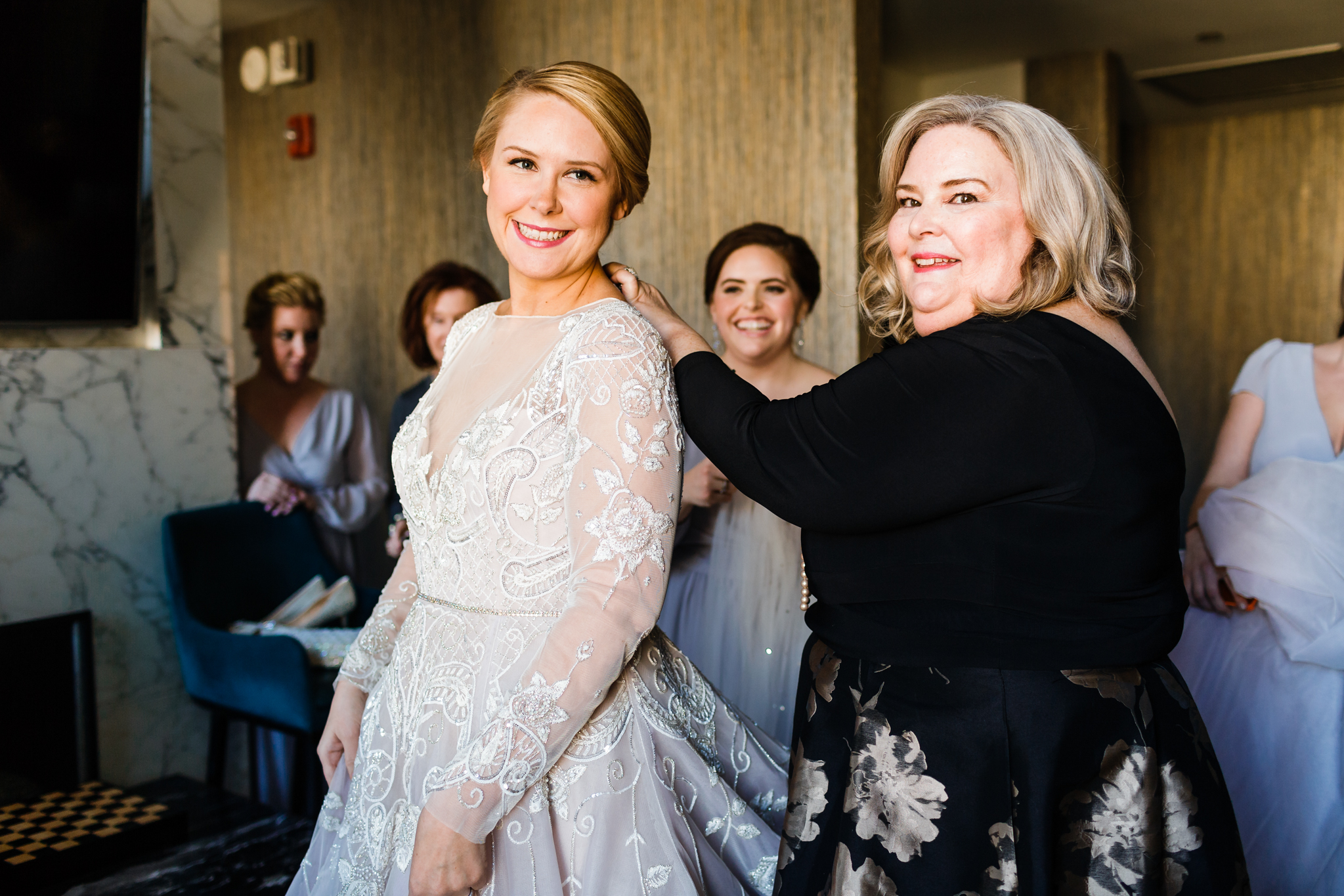 Mother and daughter share a moment on wedding day
