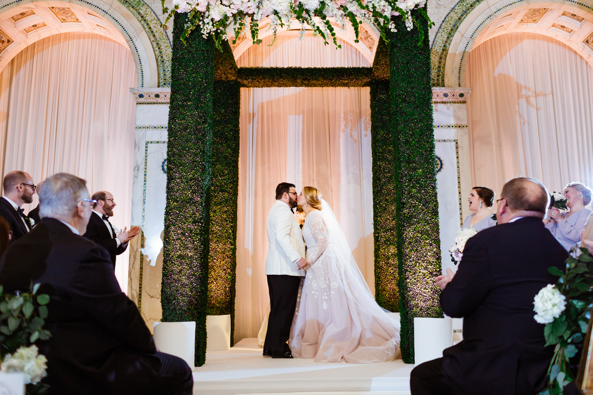 Bride and groom share a kiss underneath the Chuppah at a Chicago wedding