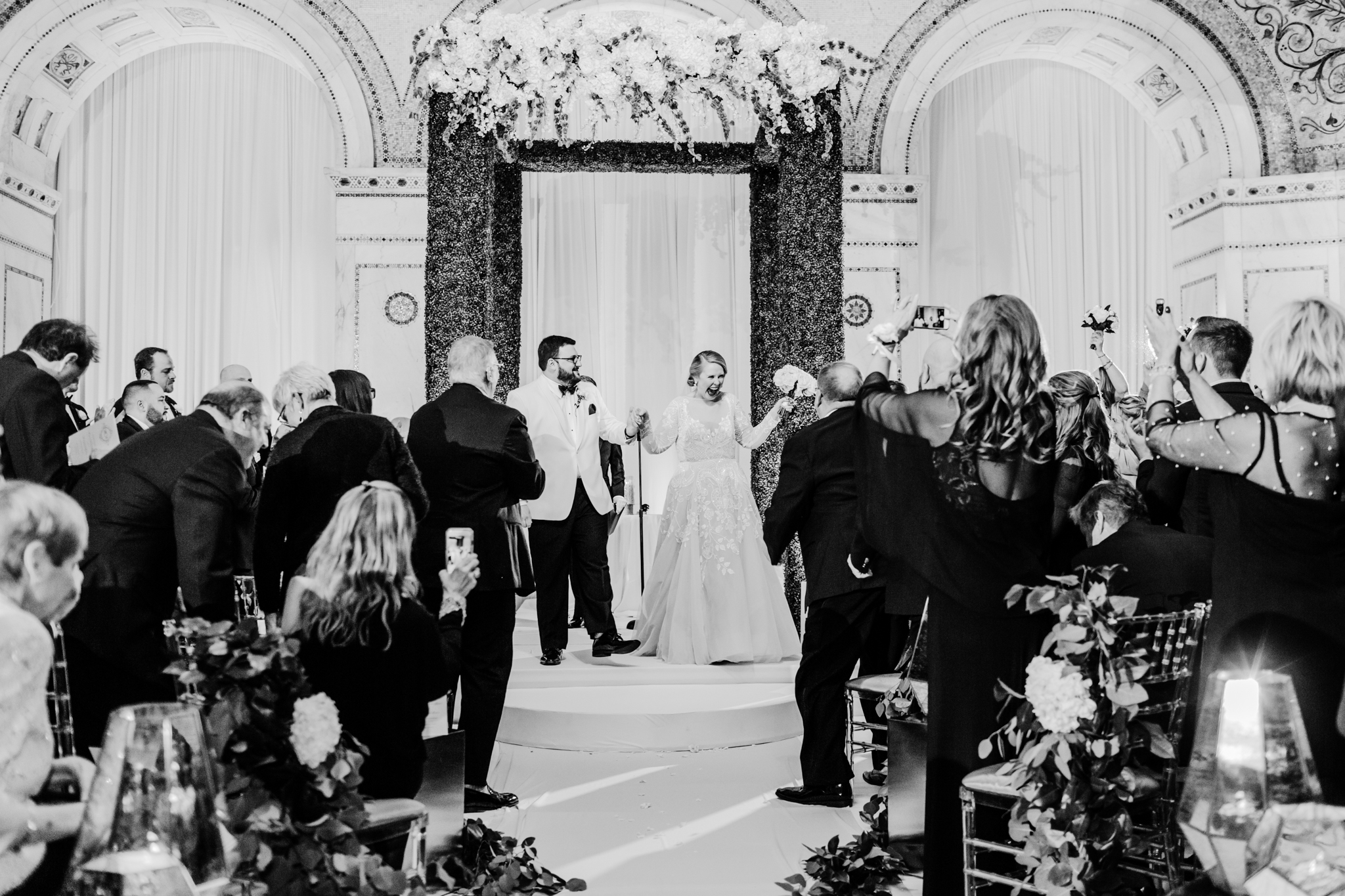 Breaking the wine glass after a wedding ceremony underneath the Chuppah
