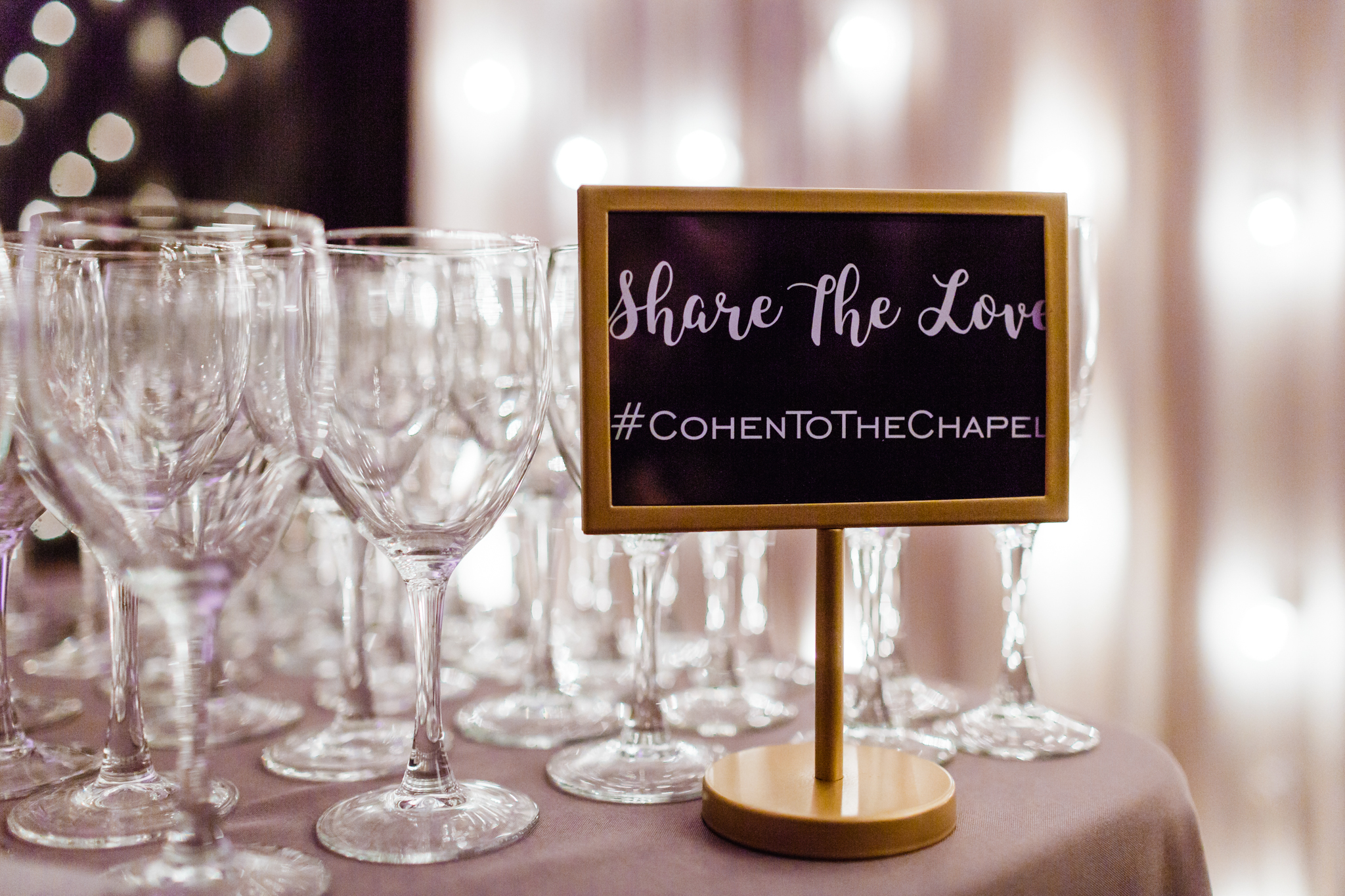 """Bar signage that reads: """"Share the Love #cohentothechapel"""""""