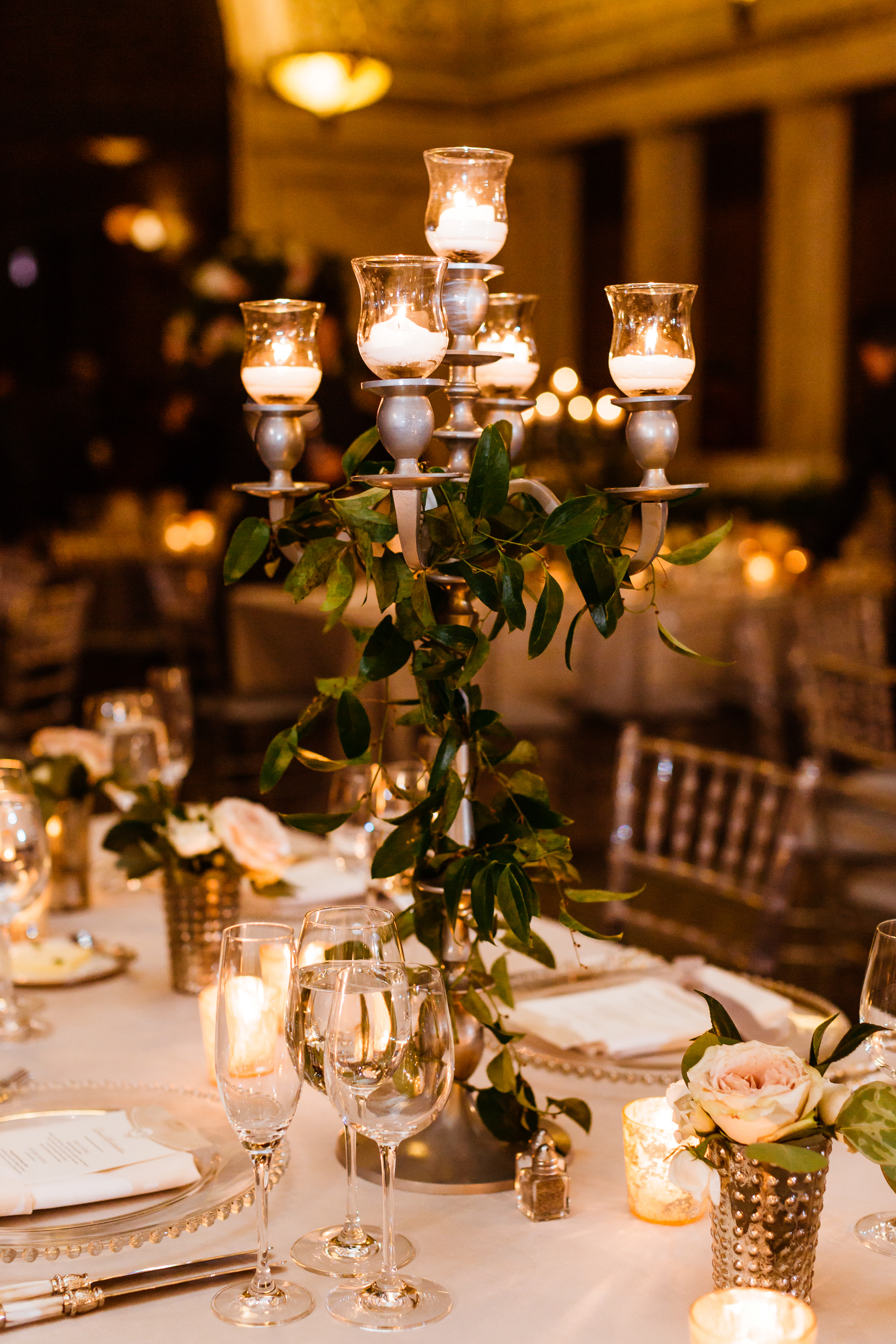 Candleabra details on tables as centerpiece