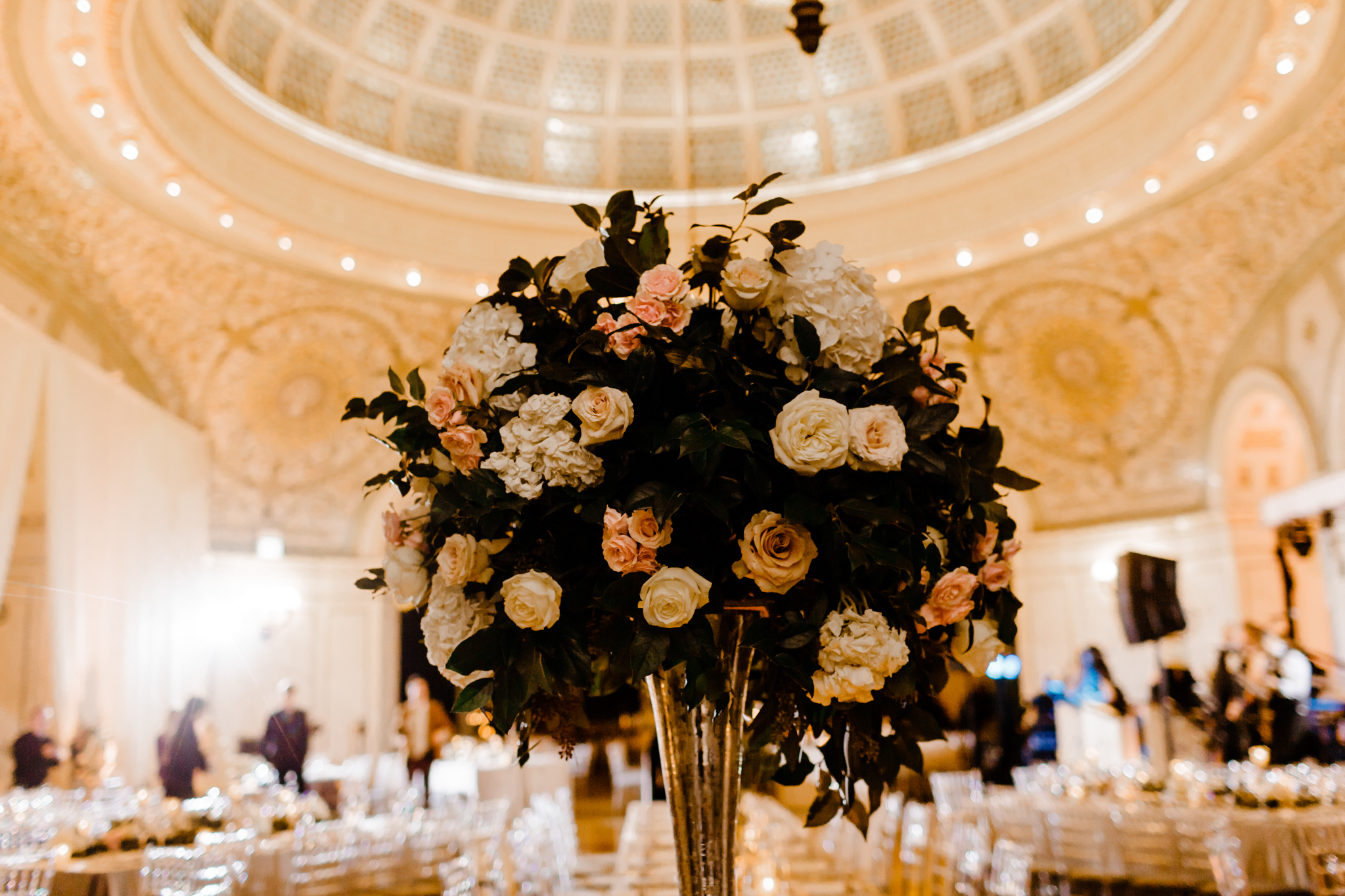 Floral centerpiece under Tiffany dome