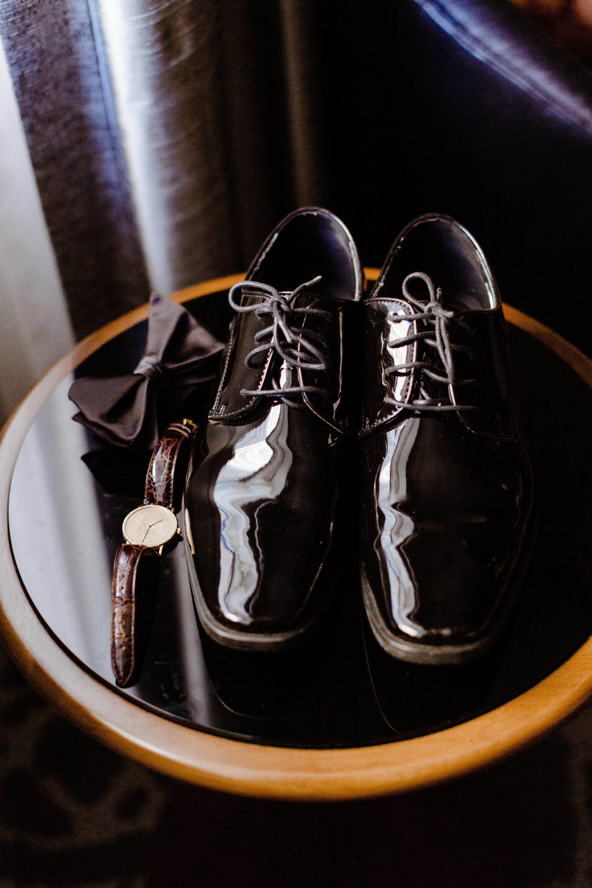 Groom details before a wedding - bowtie, shoes, watch