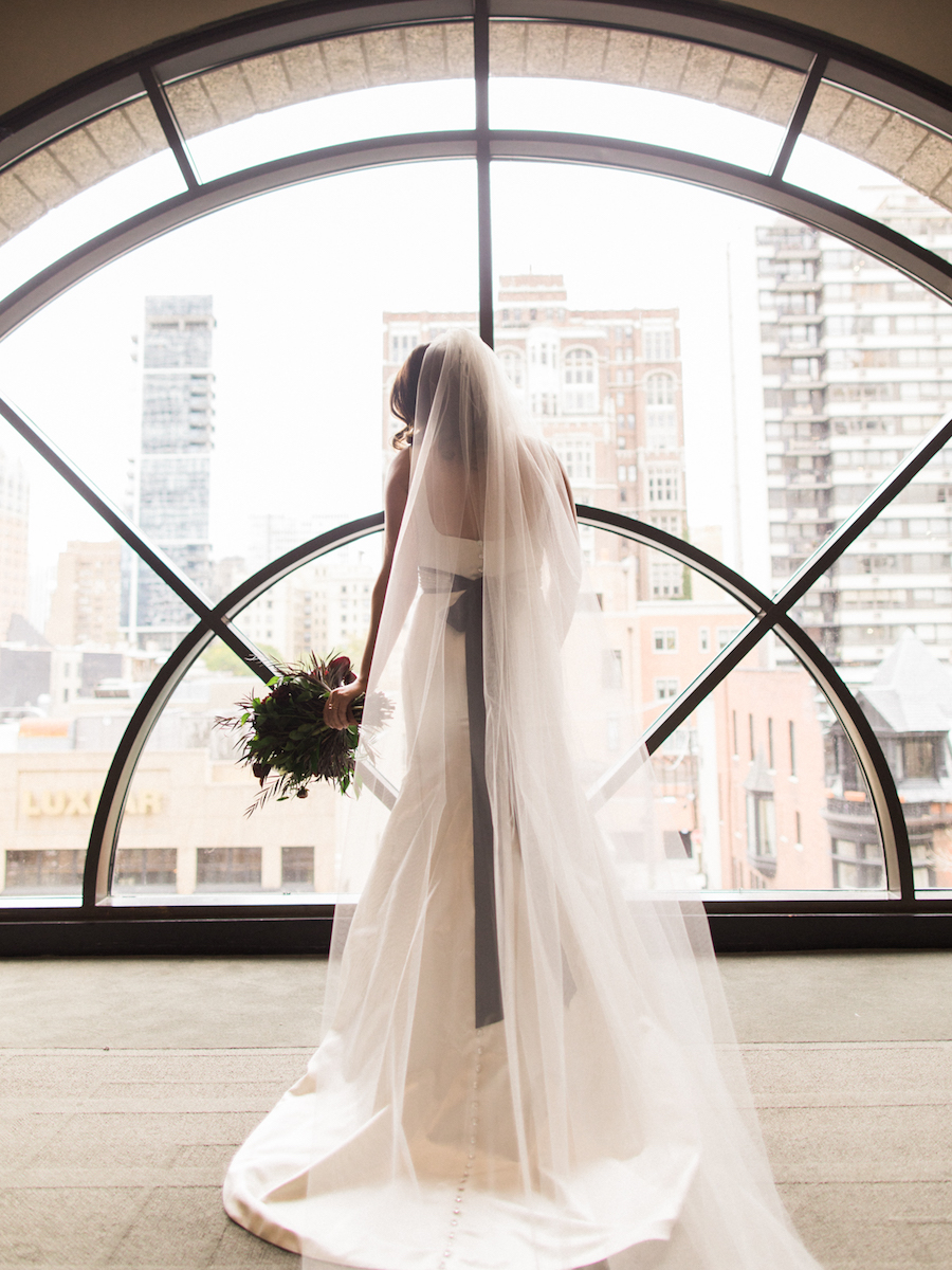 Bride overlooking the Chicago cityscape at the Thompson