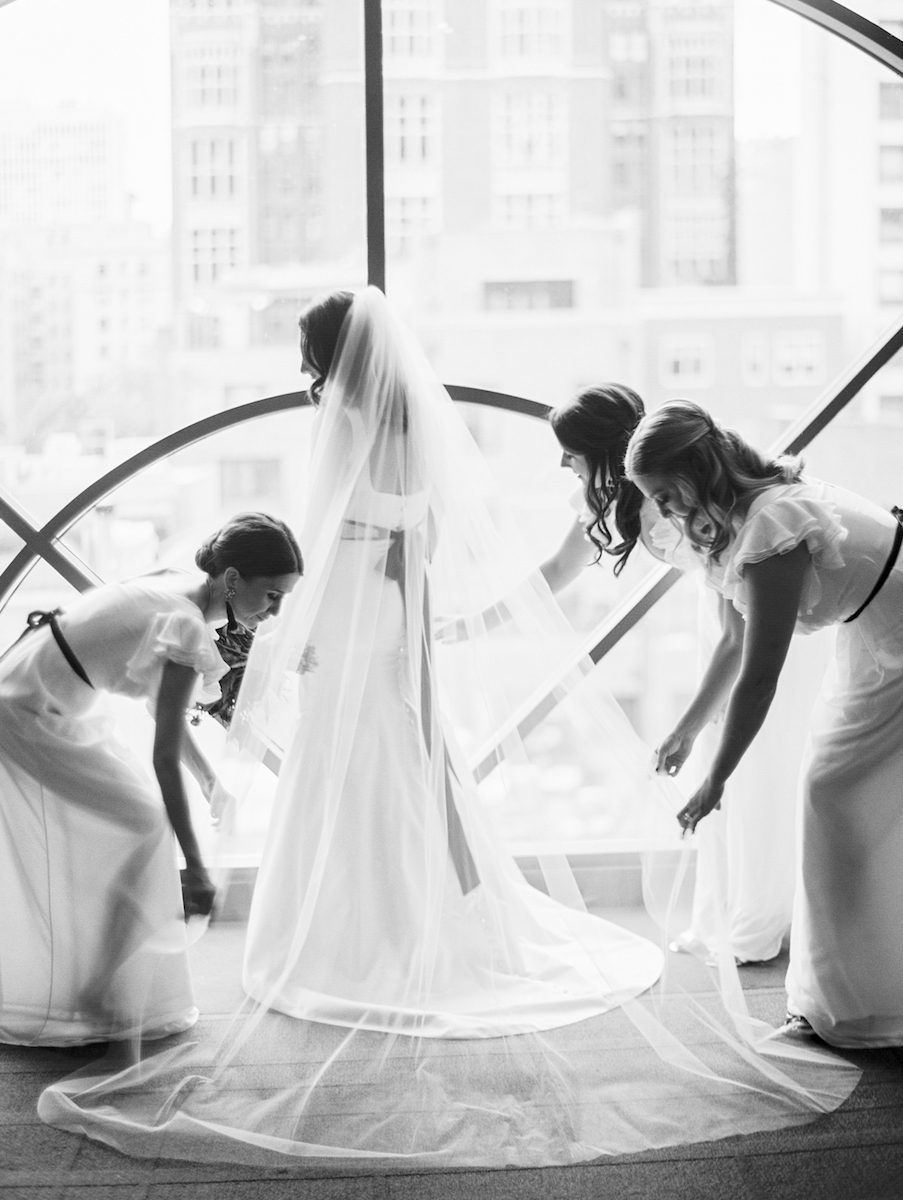 Fixing a veil on a beautiful bride at the Thompson Chicago