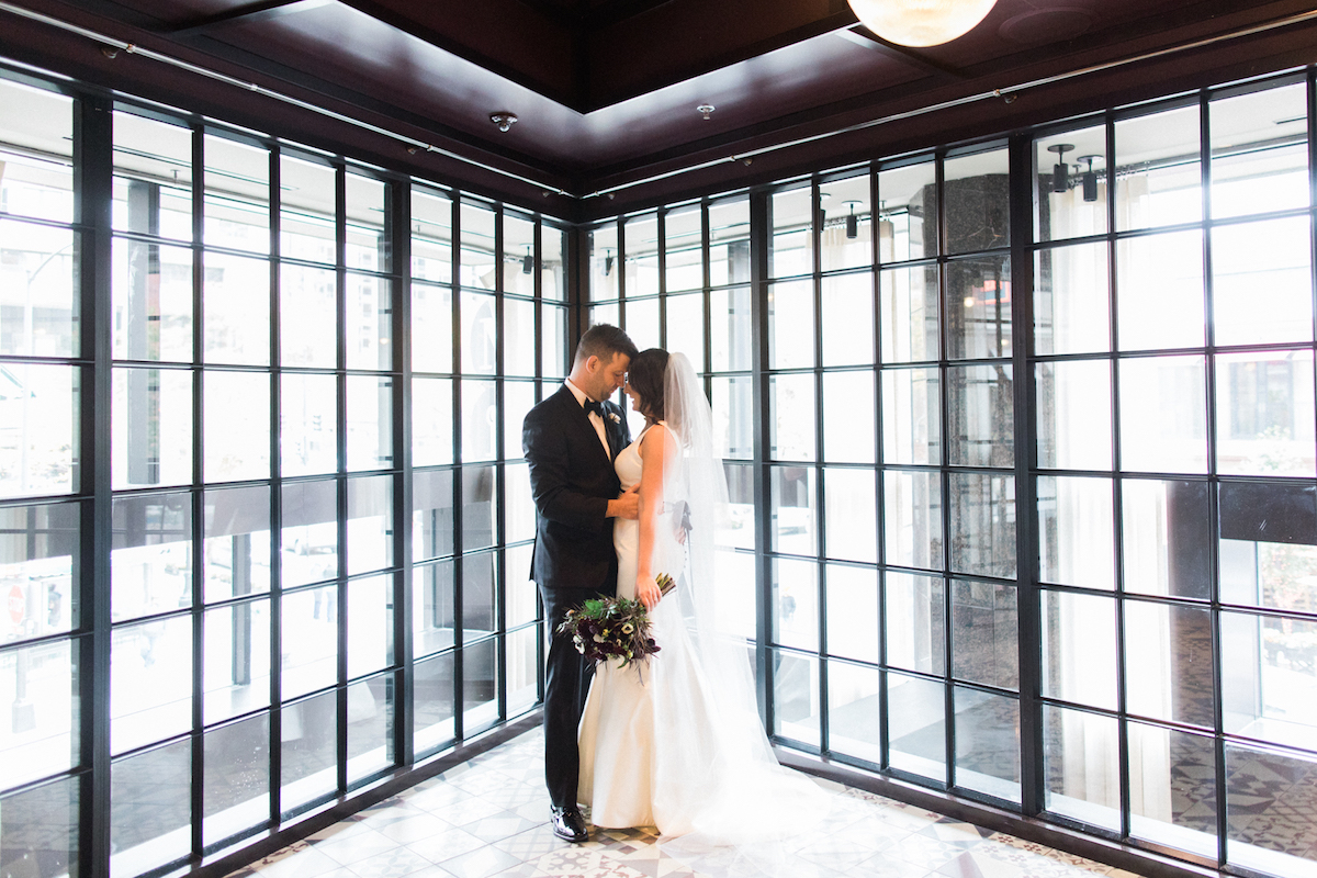 Bride and Groom share a kiss at the Thompson Chicago