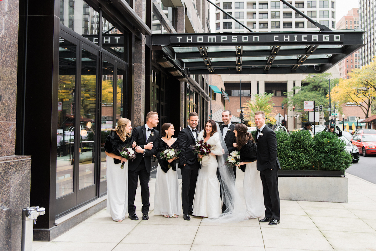 Bridal party strikes a post outside the Thompson Chicago