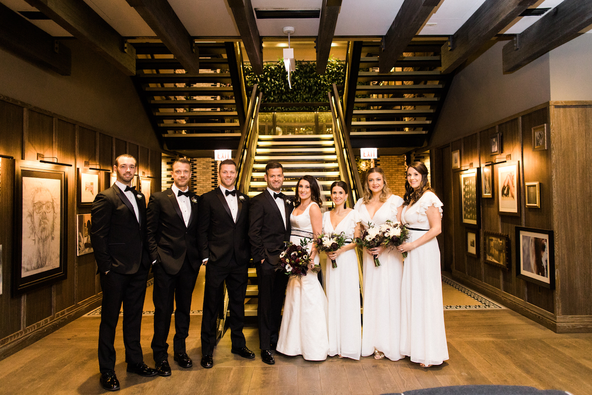 Bridal party in front of a staircase at the Thompson Chicago