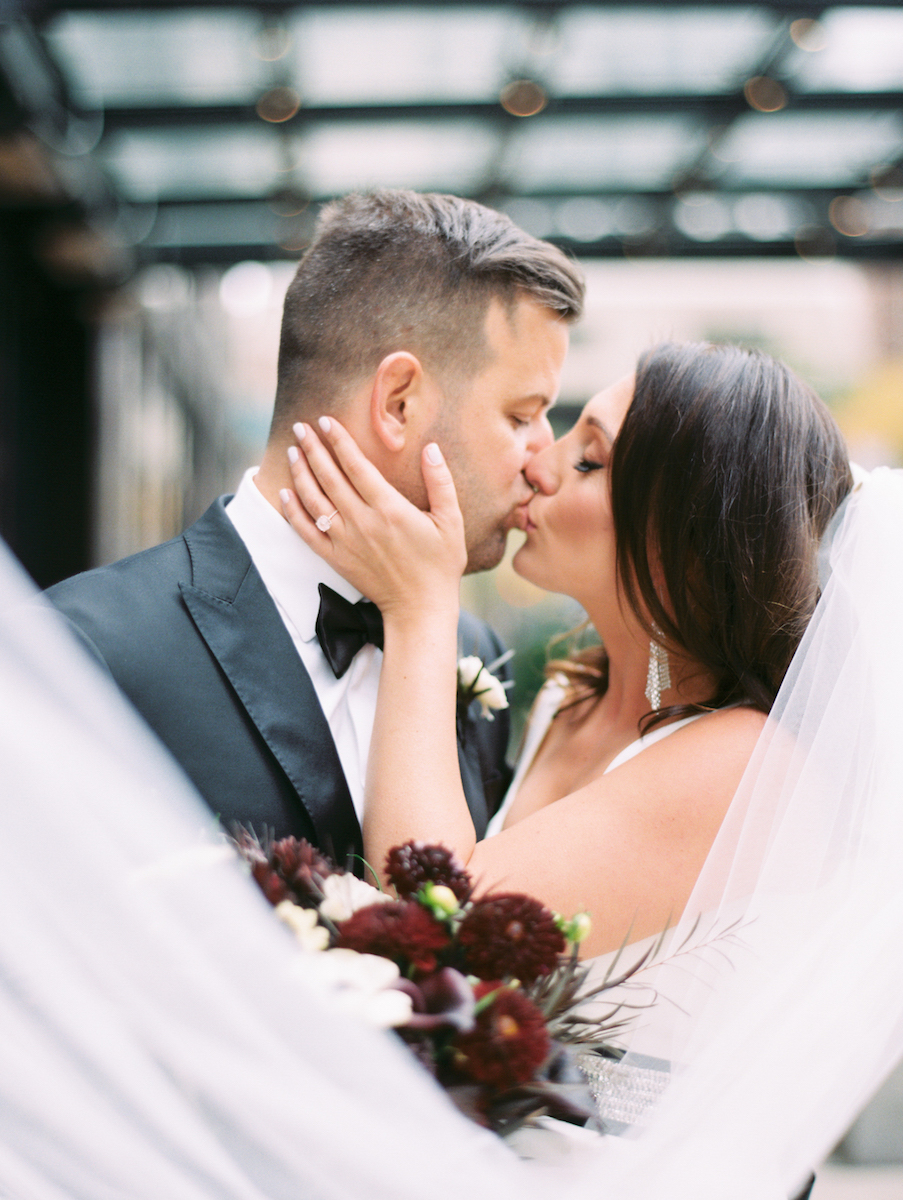 Bride and Groom kiss outside during fall in Chicago