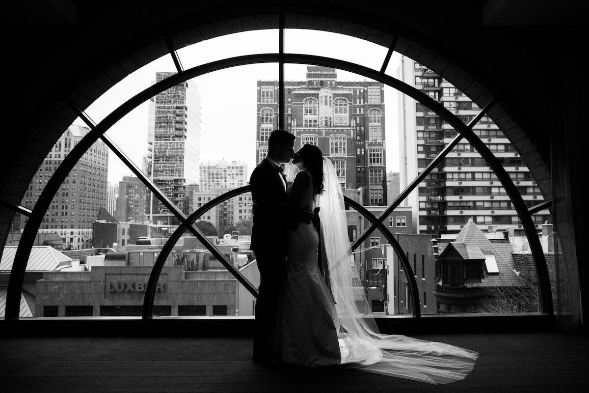 Bride and Groom Window Shot at the Thompson overlooking Downtown Chicago
