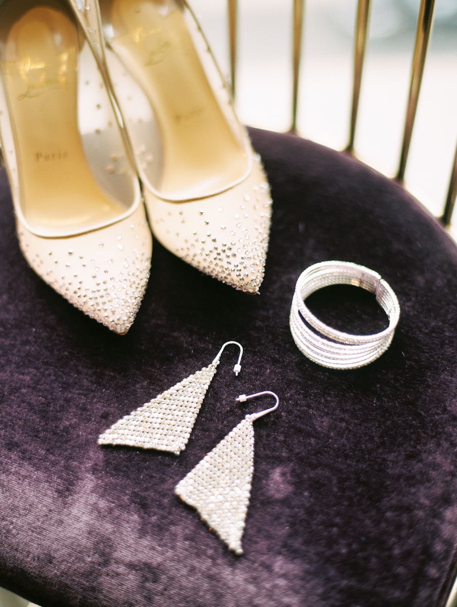 Detail shot of Christian Louboutin High Heeled Shoes with earrings and bracelet