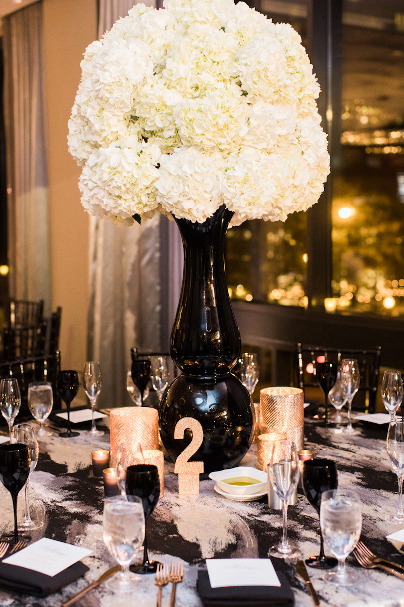 Table Two with hydrangea centerpiece, candlelight, and black elements