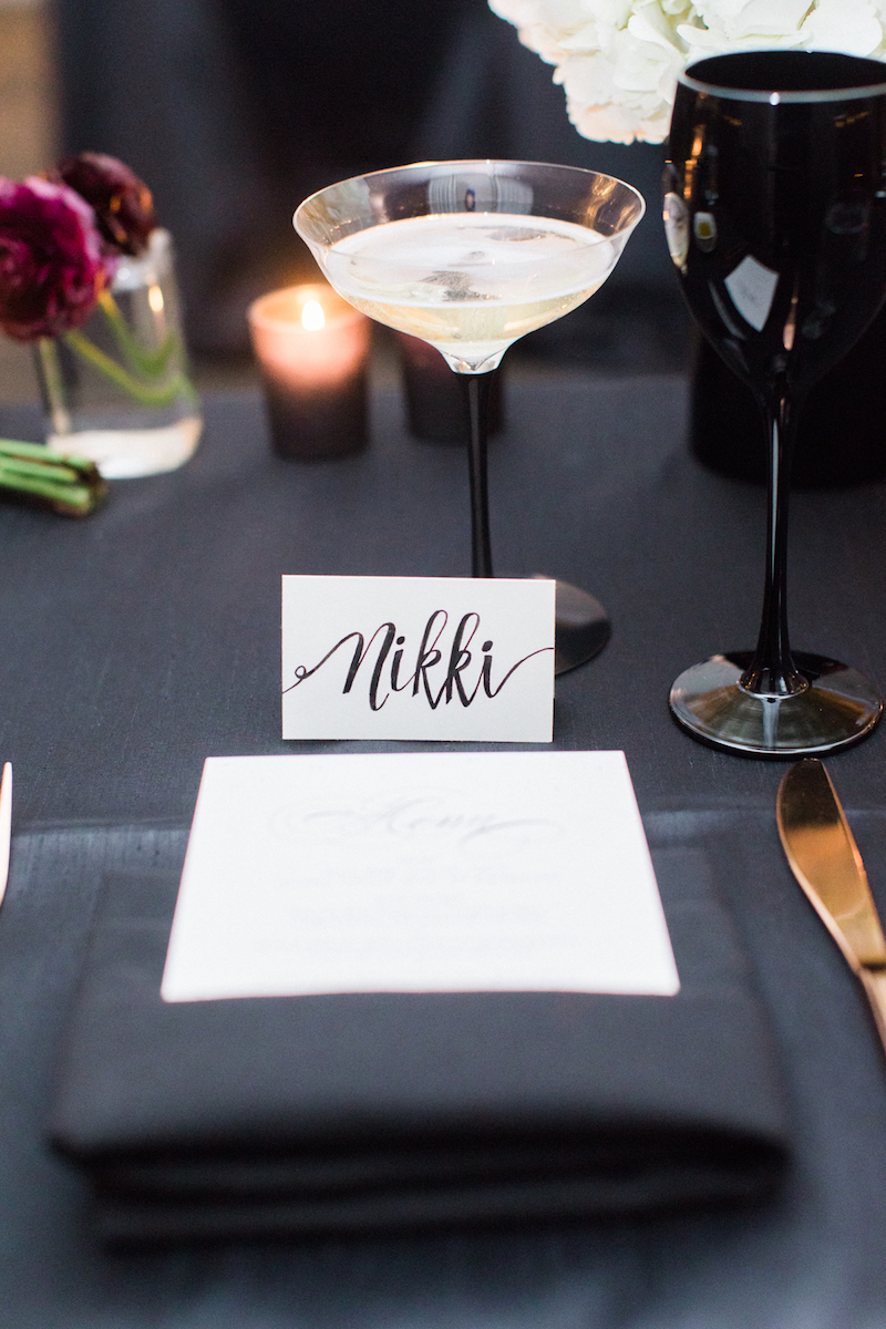 Escort card with name Nikki and martini