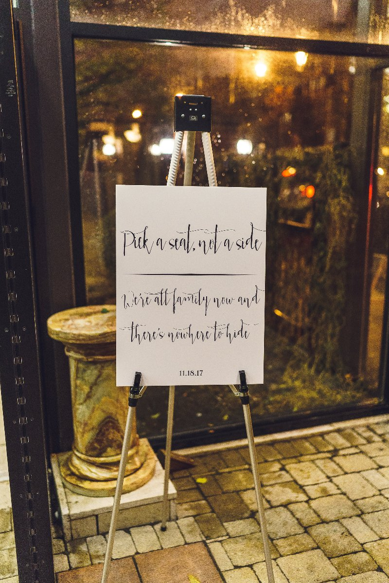 """Wedding sign that reads """"Pick a sea, not a side, we're all family now, there's nowhere to hide"""""""