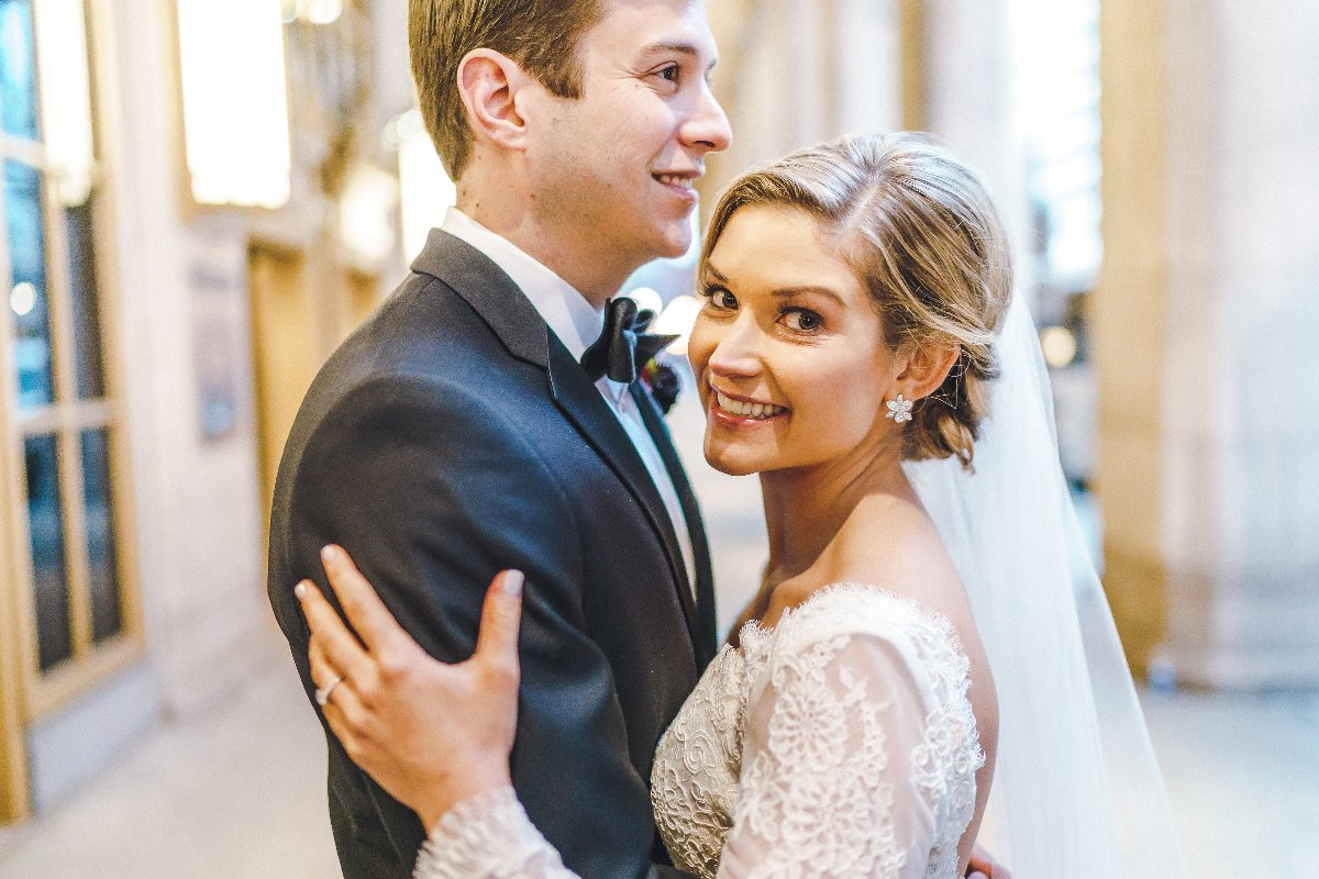 Bride and groom smiling outside the Lyric Opera downtown Chicago