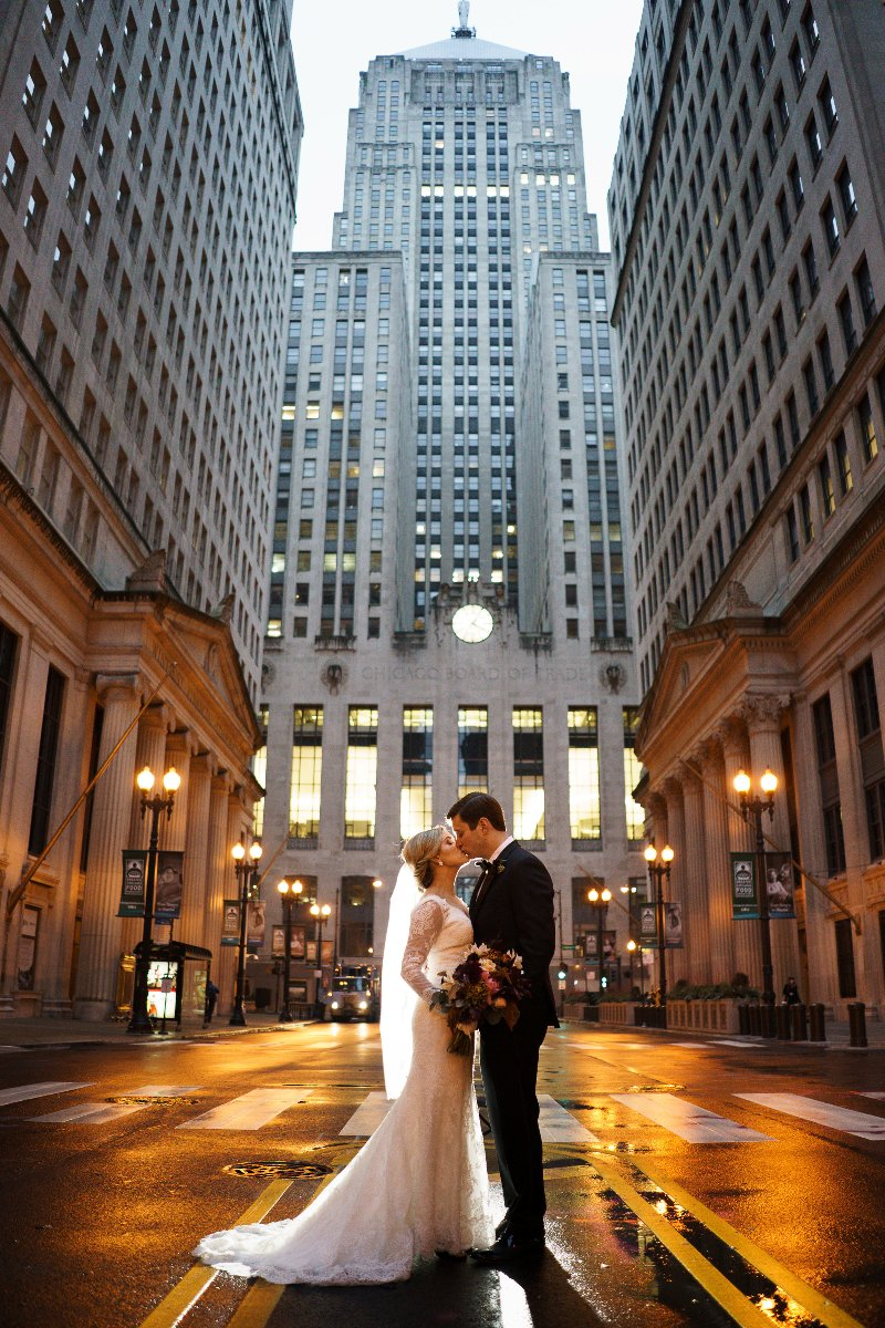 Bride and Groom kissing on the street in downtown Chicago