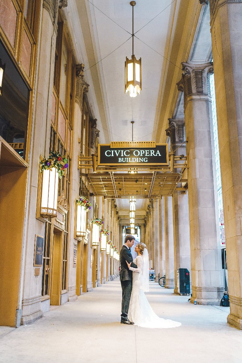 Bride and groom in front of the Lyric Opera Chicago