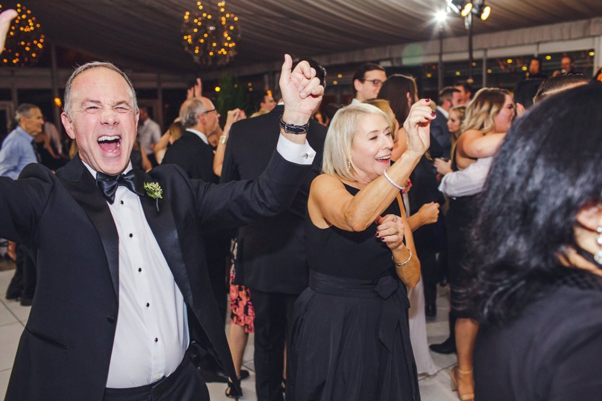 Father and mother of the bride dancing the night away at their daughter's wedding